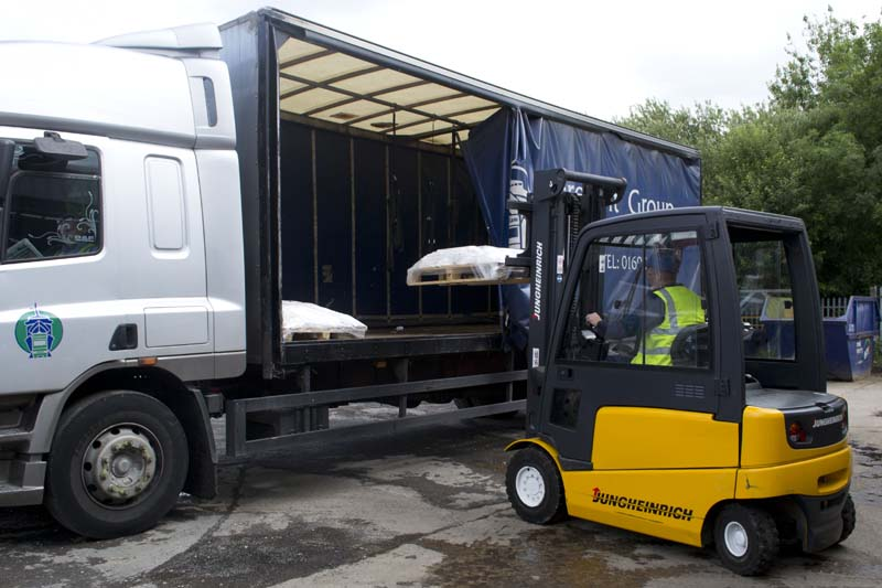 smith bullough deliveries - forklift truck loading pallets